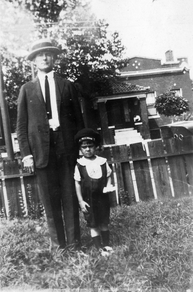 Forrest Luckett and his son, Elmer, wearing a U.S. Navy hat. C. 1925
